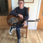 Keith Smart (Z Club Chairman) with Ronnie Lane's Zemaitis Resonator